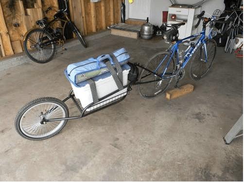 Установка велоприцепа на оси велосипеда